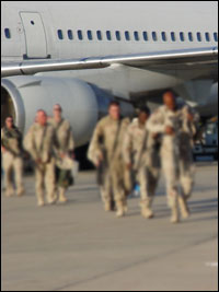 military people walking off plane